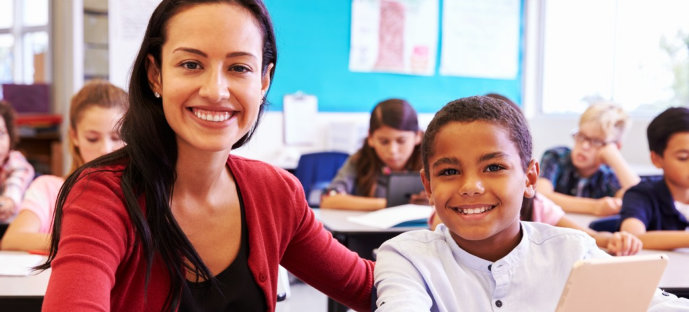 teacher and student smiling